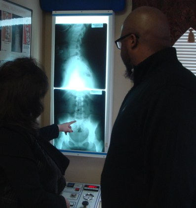 Dr. Levinson showing patient x-rays