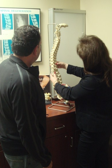 Dr. Levinson discussing chiropractic care